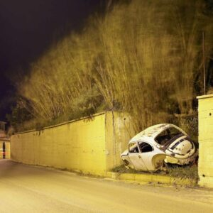 Ramzy_Zahoual, A car in a wall, 2011, from the series Handpicked Wrecks, photo print, Algeria